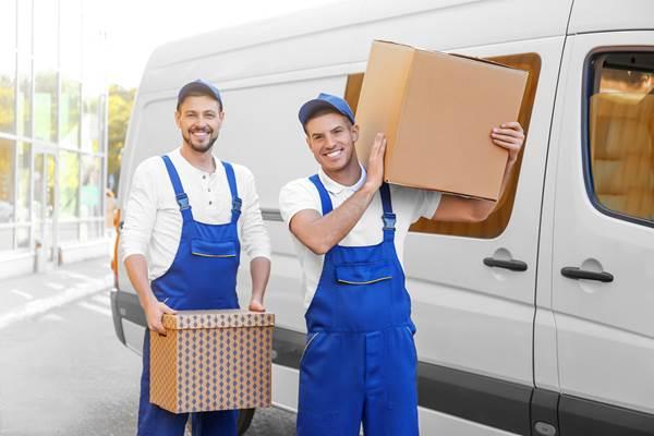 Workers next to company van