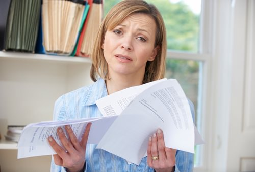 Woman overwhelmed by bills needing tips on frugal living